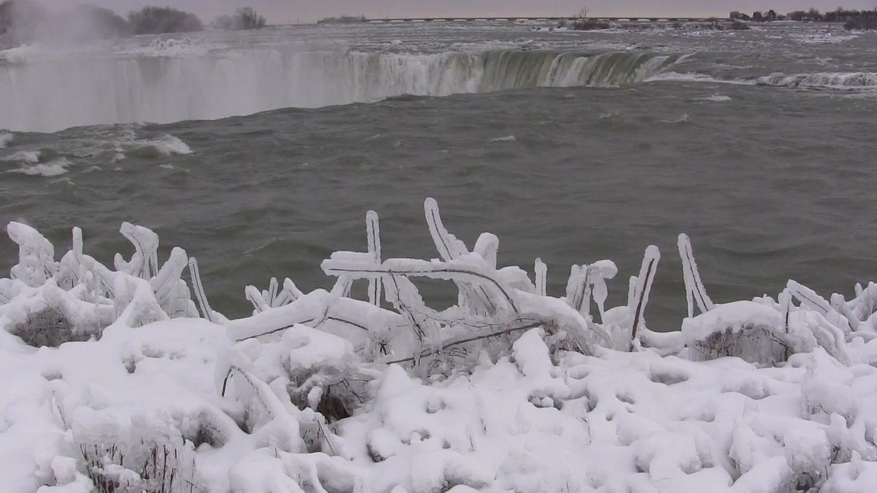 Tourists Drawn To The Stunning Beauty Of An Icy Niagara Falls