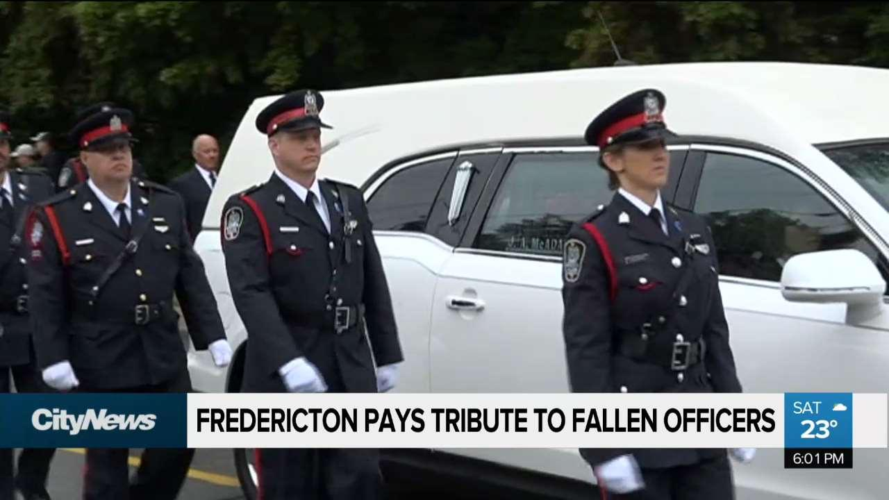 thousands attend funeral for fallen fredericton officers