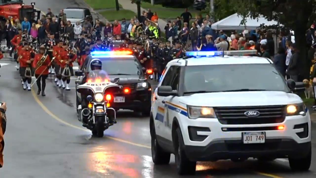 police from across canada march in fredericton funeral procession
