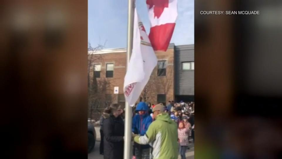 Flag raising outside Whitby school in honour of World Autism Awareness Day