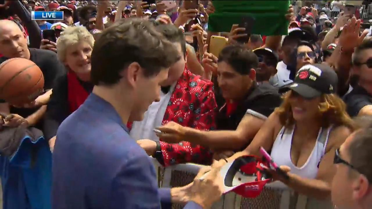 Justin Trudeau, Masai Ujiri greet people gathered for Raptors victory parade