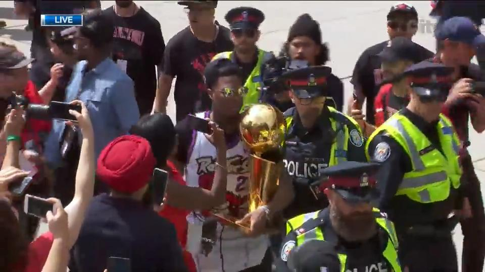 Kyle Lowry carries Larry O'Brien Championship Trophy on stage