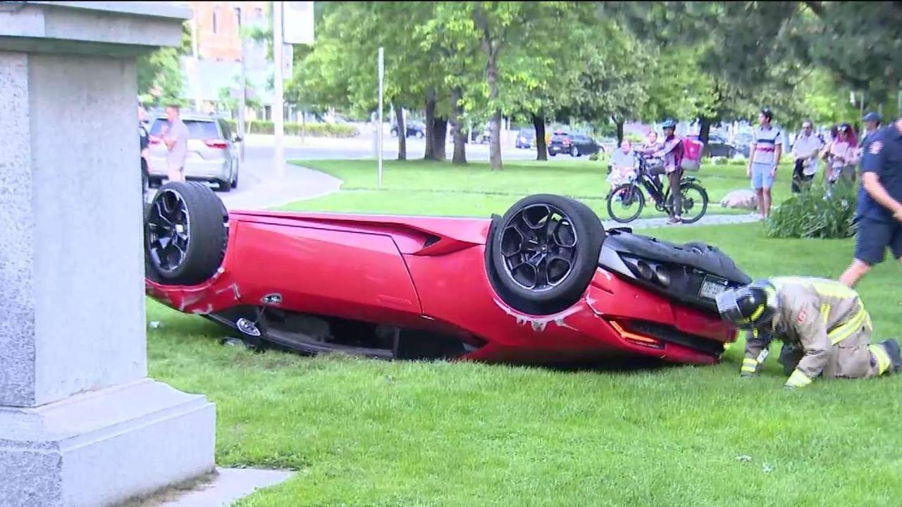 Lamborghini flips over after colliding with truck downtown