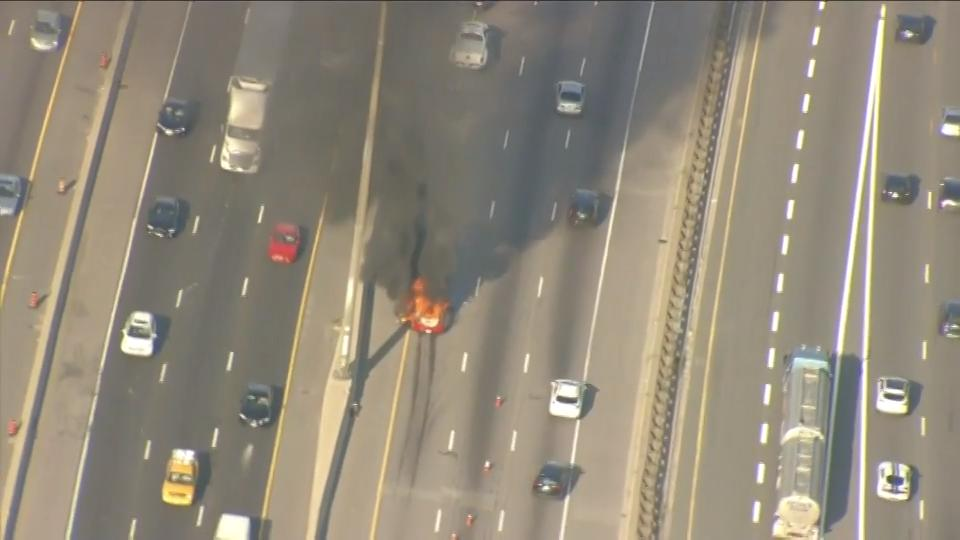 Vehicle fire causes backup on Highway 401